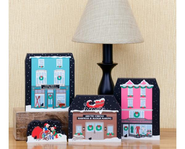"Cat's Meow Village 3/4"" thick wooden North Pole shelf sitters including glitter snow and a poem on the backs"