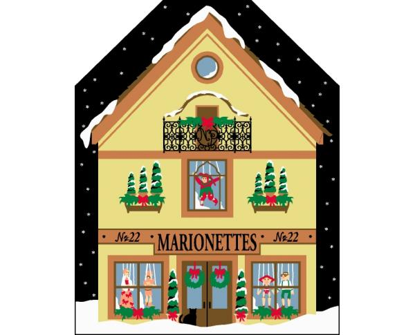 Cat's Meow Village North Pole Collection, Marionette Shop includes glittery snow.