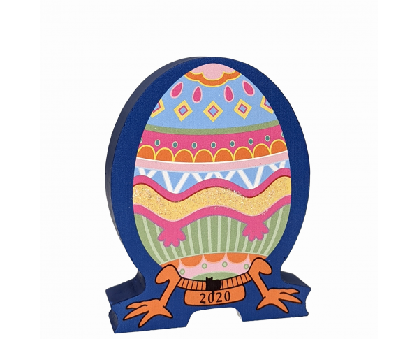 "This beautifully colored keepsake, Furbergé Egg Pink Paws 2020 is handcrafted in ¾"" thick wood for you by The Cat's Meow Village."
