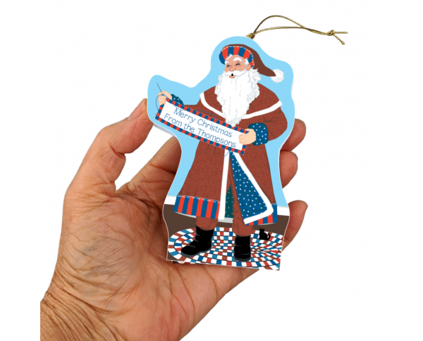 """Santa will stitch your holiday message on his quilt banner for a very personal ornament. Handcrafted in 3/4"""" thick wood by The Cat's Meow Village in Wooster, Ohio."""