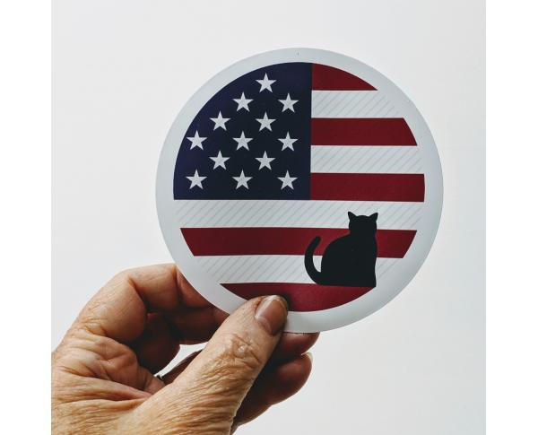 "4"" Vinyl sticker of US banner with Cat's Meow mascot, Casper"