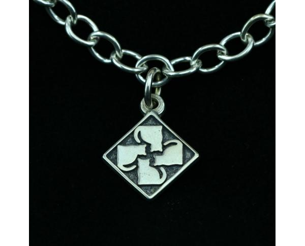 Wear a Village on your wrist! Sterling Silver Casper Quilt Charm by The Cat's Meow Village