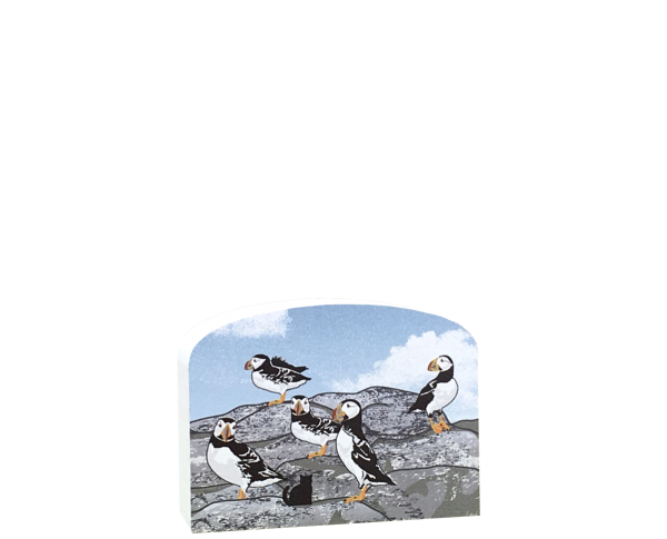 A common sight on the islands off the coast of Maine, Atlantic Puffins are only found here in the United States. Handcrafted wood replica by The Cat's Meow Village.