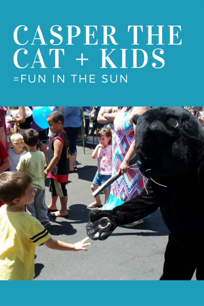 Casper, our black cat mascot, greets kids at our local Kids Day event.